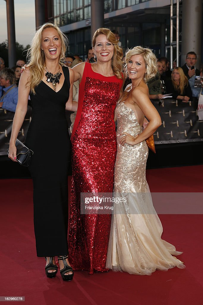 Angela Fingererben, Miriam Lange and Jennifer Knaeble attend the Deutscher Fernsehpreis 2013 - Red Carpet Arrivals at Coloneum on October 02, 2013 in Cologne, Germany.