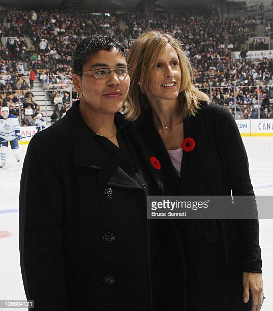 Angela James and Cammi Granato are honored for their induction into the Hockey Hall of Fame prior to the game between the Toronto Maple Leafs and the...