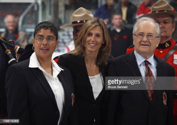 Angela James Cammi Granato and Jimmy Devallano pose for photographs following the Hockey Hall of Fame blazer ceremony prior to the Legends Classic...