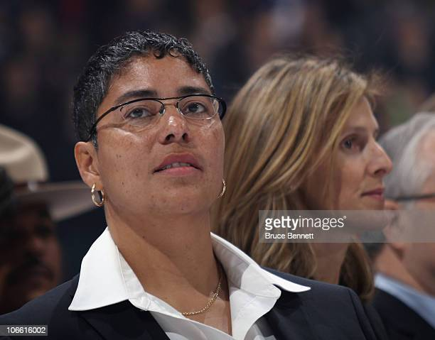 Angela James with fellow inductee Cammi Granato in the background stands at attention during the national anthem at the Hockey Hall of Fame blazer...