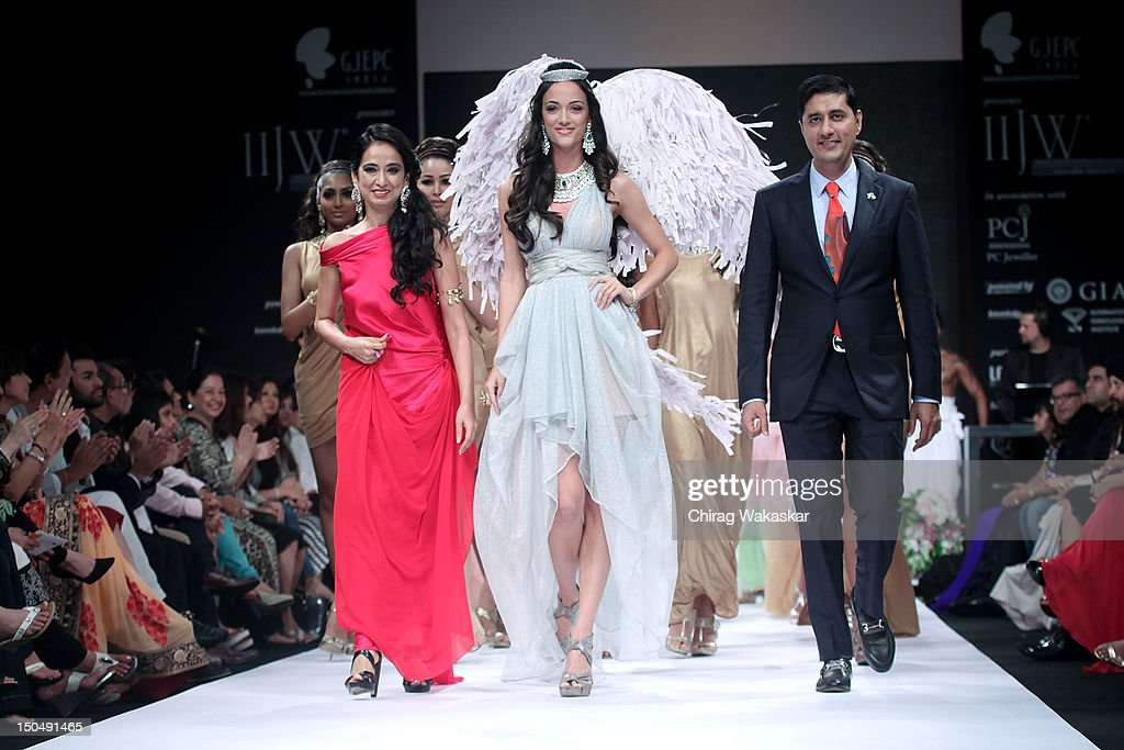 Angela Johnson (C) walks the runway in a Gehna Jewellery design at the India International Jewellery Week 2012 Day 1 at the Grand Hyatt on on August 19, 2012 in Mumbai, India.