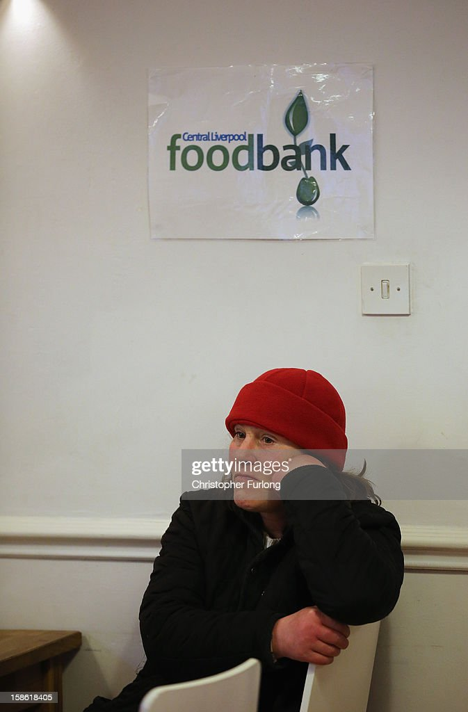 Angela Jones waits to collect essential Christmas food at Liverpool Central Foodbank on December 21, 2012 in Liverpool, England. With Christmas only days away, volunteers at the Central Liverpool Foodbank at the Frontline Trust, have seen one of their busiest days of the year as they give out free food for the needy. The centre has been giving out festive treats as well as its normal food donation - feeding over 1000 individuals in its first year, including over 300 children.