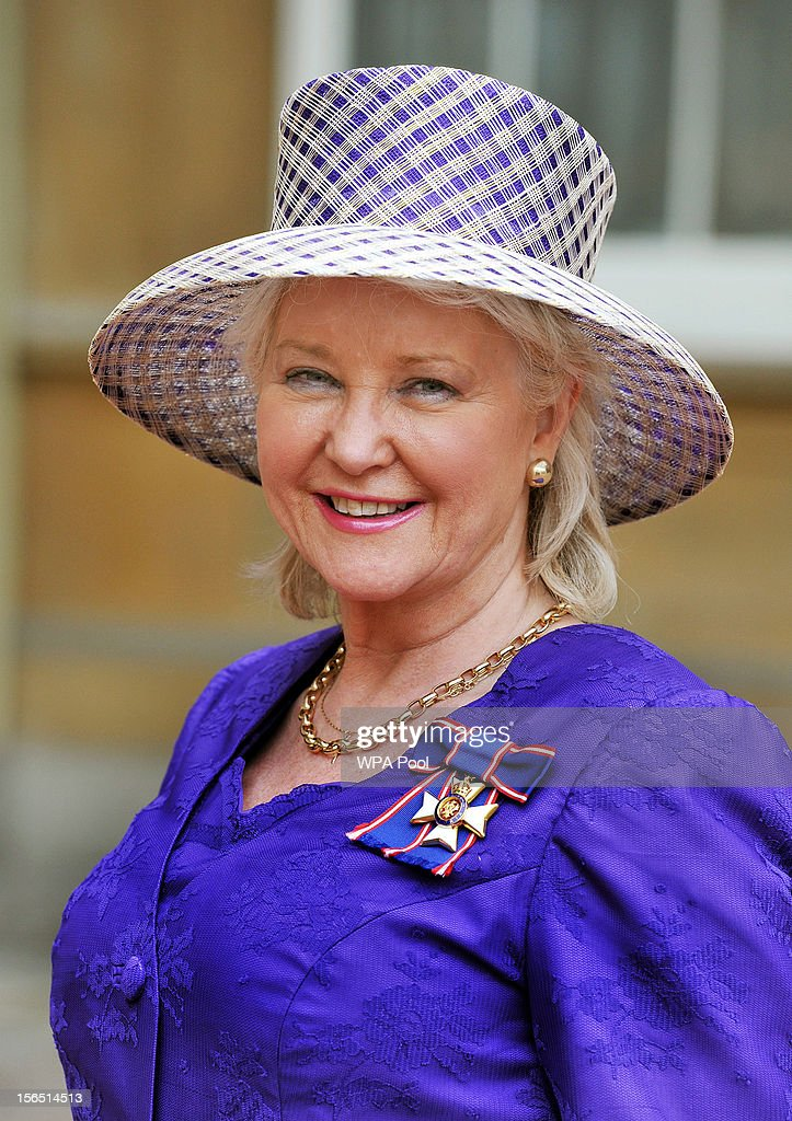 Angela Kelly the personnel dresser to Her Majesty proudly wears her Royal Victorian Order medal, after it was presented to her by Queen Elizabeth II, at the Investiture ceremony at Buckingham Palace on November 16, 2012 in London, England.