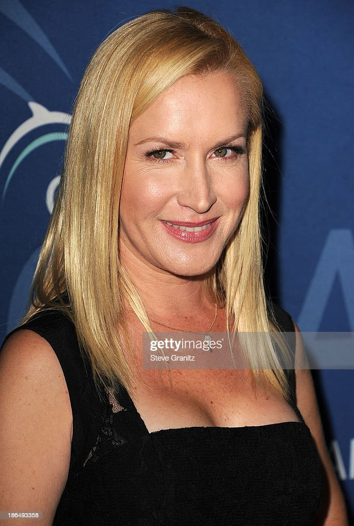 Angela Kinsey arrives at the Oceana Partners Award Gala With Former Secretary Of State Hillary Rodham Clinton and HBO CEO Richard Pleple at Regent Beverly Wilshire Hotel on October 30, 2013 in Beverly Hills, California.