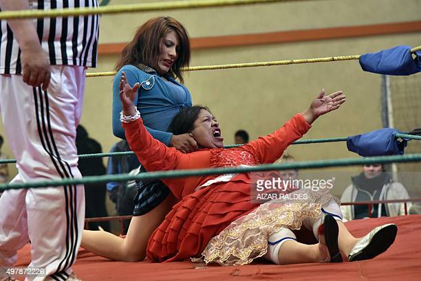 'Angela la Folclorica' fights with 'Carla Greta' during a 'cholitas' allin wrestling fight in El Alto 12 Kms from la Paz on November 15 20152015 The...