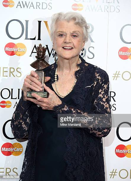 Angela Lansbury poses in the winners room at The Olivier Awards at The Royal Opera House on April 12 2015 in London England