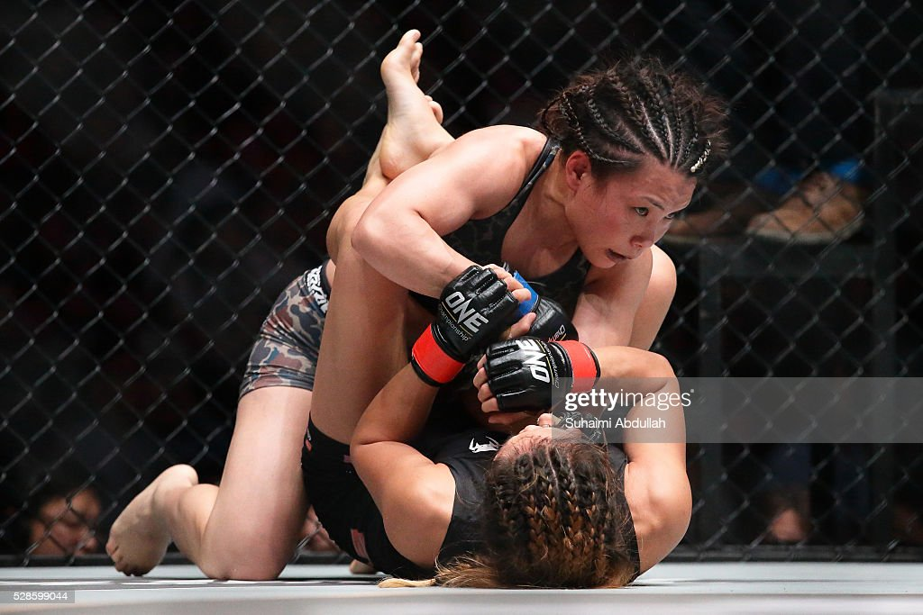 Angela Lee of Singapore (bottom) fights Mei Yamaguchi of Japan for the women's atomweight world championship during One Championship: Ascent to Power at Singapore Indoor Stadium on May 6, 2016 in Singapore.