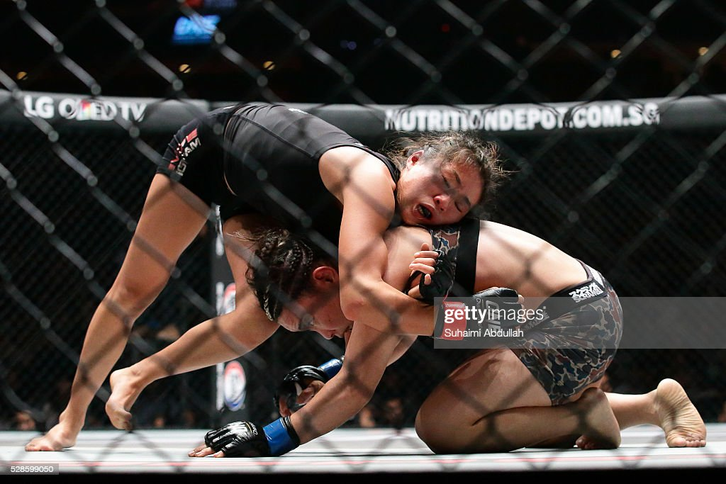 Angela Lee of Singapore (L) fights Mei Yamaguchi of Japan for the women's atomweight world championship during One Championship: Ascent to Power at Singapore Indoor Stadium on May 6, 2016 in Singapore.
