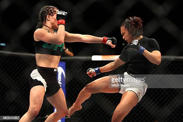Angela Magana punches Michelle Waterson in their women's strawweight bout during the Ultimate Fighter Finale inside MGM Grand Garden Arena on July 12...