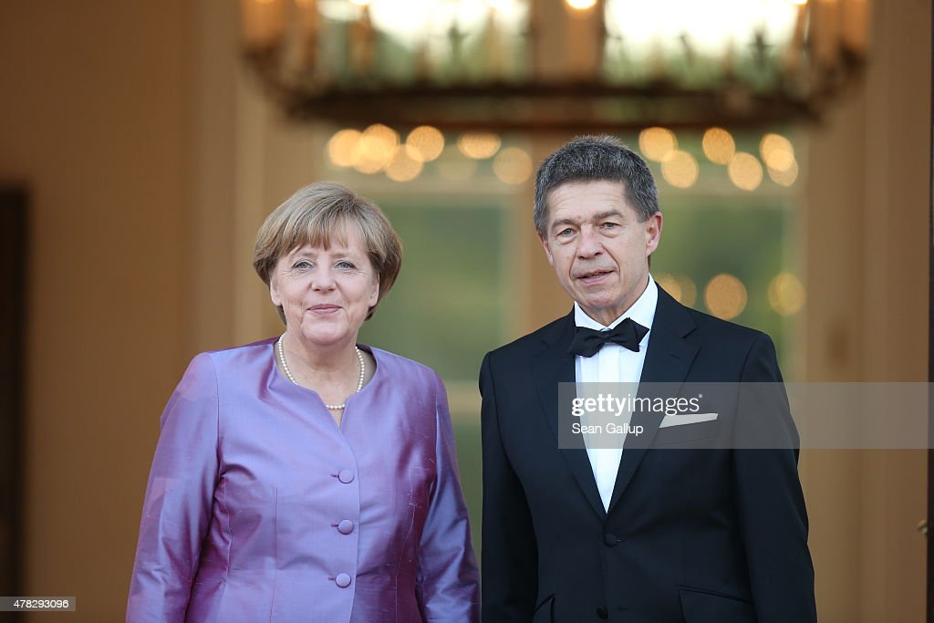 Angela Merkel and Joachim Sauer arrive at the Schloss Bellevue Palace during her visit to Germany on June 24, 2015 in Berlin, Germany. The two leaders are meeting as creditors, European Union officials and members of the Greek government scramble to find a solution to avoid a Greek state bankruptcy and departure by Greece from the Eurozone.