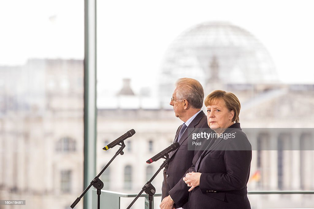 <a gi-track='captionPersonalityLinkClicked' href=/galleries/search?phrase=Angela+Merkel&family=editorial&specificpeople=202161 ng-click='$event.stopPropagation()'>Angela Merkel</a> and visiting Italian Prime Minister <a gi-track='captionPersonalityLinkClicked' href=/galleries/search?phrase=Mario+Monti&family=editorial&specificpeople=632091 ng-click='$event.stopPropagation()'>Mario Monti</a> attend a press conference before their meeting at the Chancellery on January 31, 2013 in Berlin, Germany. The German Chancellor is meeting with Italian Prime Minister <a gi-track='captionPersonalityLinkClicked' href=/galleries/search?phrase=Mario+Monti&family=editorial&specificpeople=632091 ng-click='$event.stopPropagation()'>Mario Monti</a> and Spanish Prime Minister Mariano Rajoy in Berlin to hold EU budget talks in preparation for the EU Summit to be held in Brussels next week.
