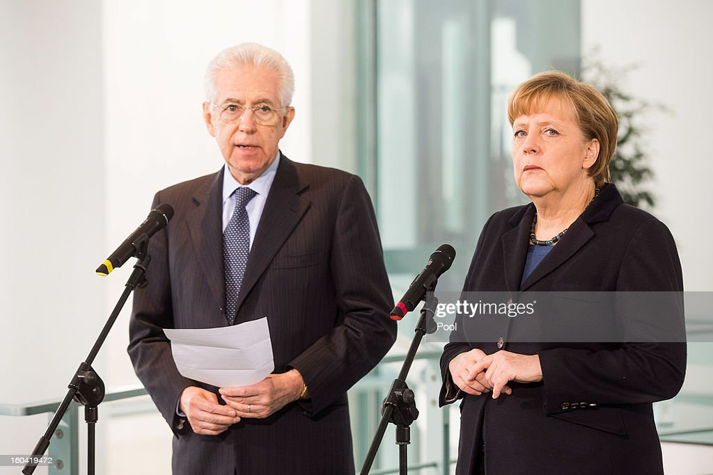 Angela Merkel and visiting Italian Prime Minister Mario Monti speaks to the media before their meeting at the Chancellery on January 31, 2013 in Berlin, Germany. The German Chancellor is meeting with Italian Prime Minister Mario Monti and Spanish Prime Minister Mariano Rajoy in Berlin to hold EU budget talks in preparation for the EU Summit to be held in Brussels next week.