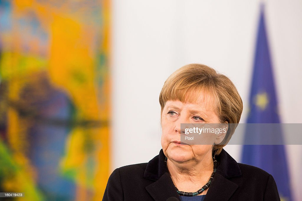 <a gi-track='captionPersonalityLinkClicked' href=/galleries/search?phrase=Angela+Merkel&family=editorial&specificpeople=202161 ng-click='$event.stopPropagation()'>Angela Merkel</a> attends a press conference with visiting Italian Prime Minister Mario Monti (not pictured) before their meeting at the Chancellery on January 31, 2013 in Berlin, Germany. The German Chancellor is meeting with Italian Prime Minister Mario Monti and Spanish Prime Minister Mariano Rajoy in Berlin to hold EU budget talks in preparation for the EU Summit to be held in Brussels next week.