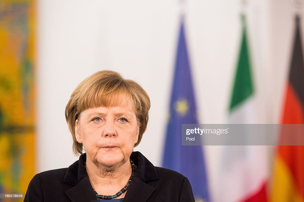 Angela Merkel attends a press conference with visiting Italian Prime Minister Mario Monti (not pictured) before their meeting at the Chancellery on January 31, 2013 in Berlin, Germany. The German Chancellor is meeting with Italian Prime Minister Mario Monti and Spanish Prime Minister Mariano Rajoy in Berlin to hold EU budget talks in preparation for the EU Summit to be held in Brussels next week.