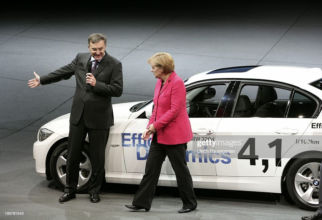 Angela MERKEL, CDU, Federal chancellor and chairwoman of CDU and Norbert REITHOFER, CEO chief executive officer of BMW AG, at the exhibition stand of BMW with the economical BMW 320d at the IAA International Motor Show in Frankfurt Main.