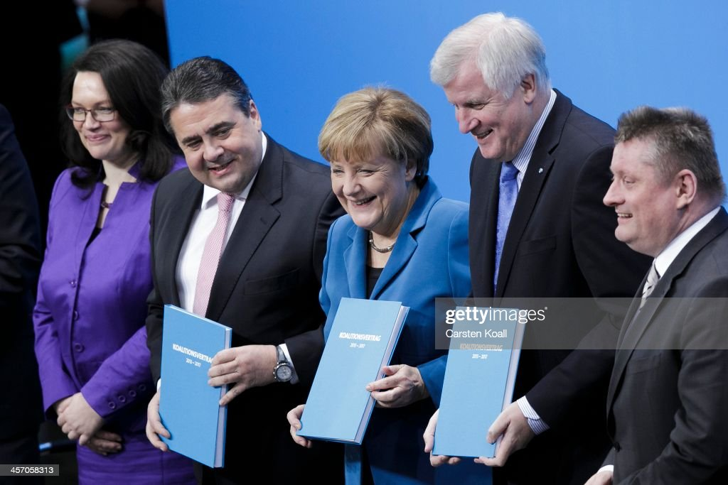 Angela Merkel, Chancellor and Chairwoman of the German Christian Democrats (CDU), <a gi-track='captionPersonalityLinkClicked' href=/galleries/search?phrase=Horst+Seehofer&family=editorial&specificpeople=4273631 ng-click='$event.stopPropagation()'>Horst Seehofer</a> (R), Chairman of the Bavarian Christian Democrats (CSU) and <a gi-track='captionPersonalityLinkClicked' href=/galleries/search?phrase=Sigmar+Gabriel&family=editorial&specificpeople=543927 ng-click='$event.stopPropagation()'>Sigmar Gabriel</a>, Chairman of the German Social Democrats (SPD), pose after signing the coalition agreement between the three parties that seals their cooperation and allows the creation of a new German coalition government as new cabinet members Minister of Work and Social Issues Andrea Nahles (L) and Health Minister Hermann Groehe look on under a slogan that reads: 'Creating Germany's Future' on December 16, 2013 in Berlin, Germany. The new government is scheduled to be sworn in tomorrow.