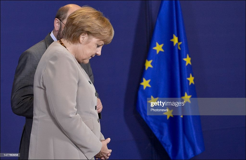 <a gi-track='captionPersonalityLinkClicked' href=/galleries/search?phrase=Angela+Merkel&family=editorial&specificpeople=202161 ng-click='$event.stopPropagation()'>Angela Merkel</a>, Chancellor of Germany stands by the European flag at the European Summit on June 28, 2012 in Brussels, Belgium.Leaders are meeting to discuss the Multiannual Financial Framework, the European Semester and the European growth agenda.