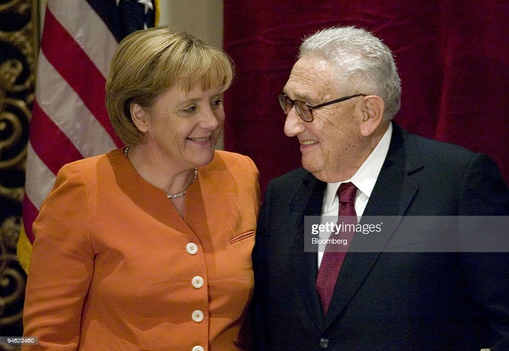http://media.gettyimages.com/photos/angela-merkel-chancellor-of-the-federal-republic-of-germany-left-picture-id94620460