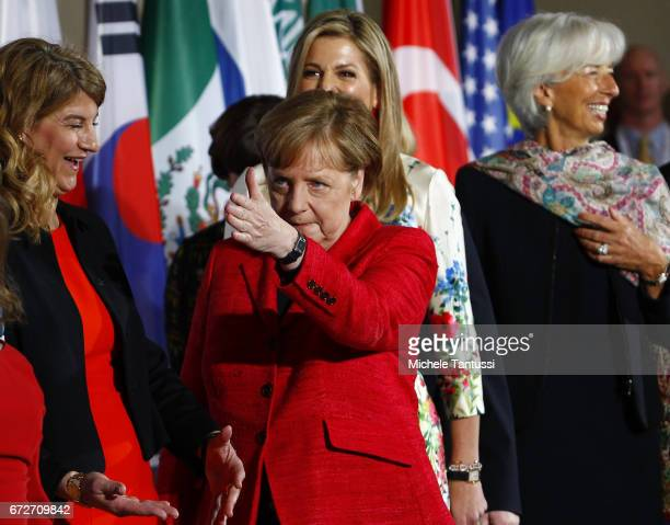 Angela Merkel Federal Chancellor of Germany gestures during a Family Photo with Stephanie Bschorr President Association of German Women Chrystia...