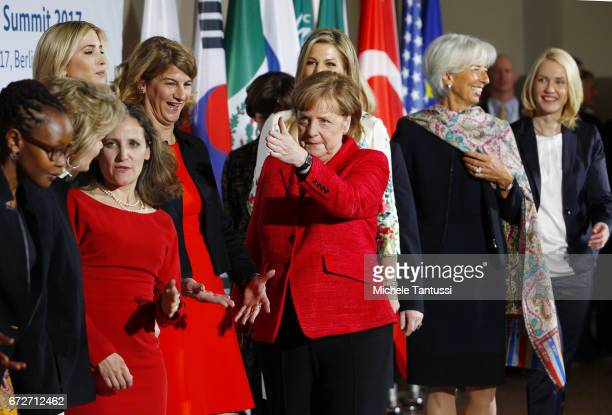 Angela Merkel Federal Chancellor of Germany gestures during a Family Photo with Stephanie Bschorr President of the Association of German Women...