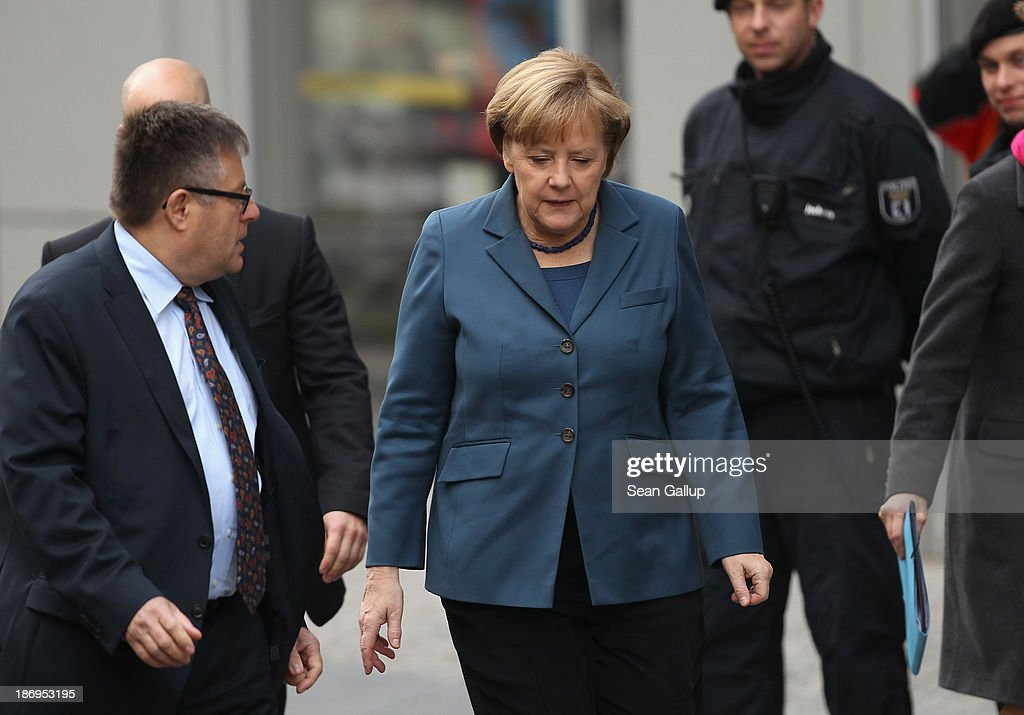 <a gi-track='captionPersonalityLinkClicked' href=/galleries/search?phrase=Angela+Merkel&family=editorial&specificpeople=202161 ng-click='$event.stopPropagation()'>Angela Merkel</a> (C), German Chancellor and Chairwoman of the German Christian Democrats (CDU), arrives at the Bavarian state representation for coalition negotiations with the German Social Democrats (SPD) and Bavarian Christian Democrats (CSU) on November 5, 2013 in Berlin, Germany. The SPD, CSU and CDU are hashing through policy issues in an effort to create a new German colaition government following elections in September.