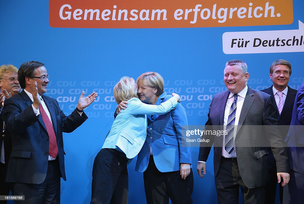 Angela Merkel, German Chancellor and Chairwoman of the German Christian Democrats (CDU), gets a hug from Minister of Work and Social Issues Ursula von der Leyen while celebrating with other members of her party, including CDU General Secretary Hermann Groehe (2nd from R), at CDU headquarters after initial results give the CDU 42% of the vote in German federal elections on September 22, 2013 in Berlin, Germany. Germany is holding federal elections that will determine whether Merkel will remain chancellor for a third term. Though the CDU has a strong lead over the opposition, its partner party in the current government coalition, the German Free Democrats (FDP), failed to gain the 5% necessary to retain seats in the Bundestag and speculations run wide as to what coalition will be viable in coming weeks to create a new government.