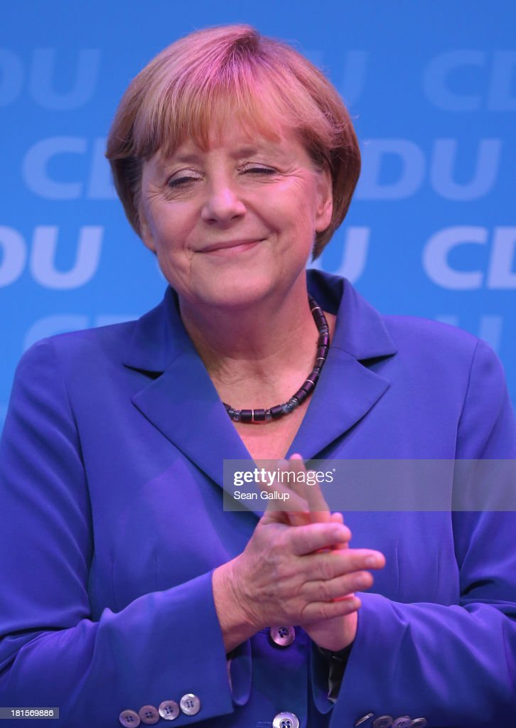 <a gi-track='captionPersonalityLinkClicked' href=/galleries/search?phrase=Angela+Merkel&family=editorial&specificpeople=202161 ng-click='$event.stopPropagation()'>Angela Merkel</a>, German Chancellor and Chairwoman of the German Christian Democrats (CDU), is bathed in purplr light as she celebrates with other members f her party at CDU headquarters after initial results give the CDU 42% of the vote in German federal elections on September 22, 2013 in Berlin, Germany. Germany is holding federal elections that will determine whether Merkel will remain chancellor for a third term. Though the CDU has a strong lead over the opposition, its partner party in the current government coalition, the German Free Democrats (FDP), failed to gain the 5% necessary to retain seats in the Bundestag and speculations run wide as to what coalition will be viable in coming weeks to create a new government.