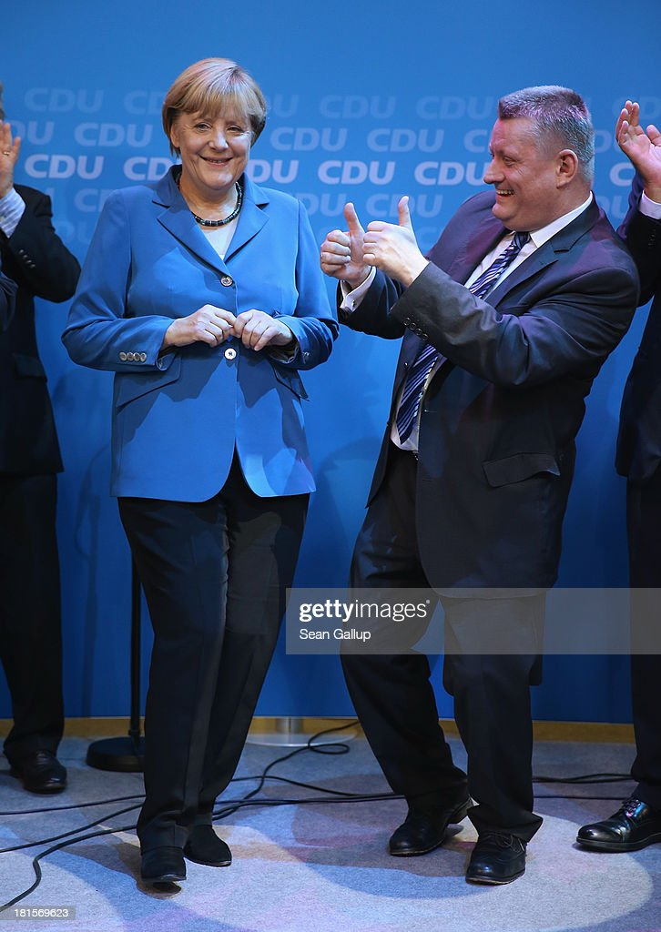 <a gi-track='captionPersonalityLinkClicked' href=/galleries/search?phrase=Angela+Merkel&family=editorial&specificpeople=202161 ng-click='$event.stopPropagation()'>Angela Merkel</a>, German Chancellor and Chairwoman of the German Christian Democrats (CDU), celebrates with supporters, including CDU General Secretary <a gi-track='captionPersonalityLinkClicked' href=/galleries/search?phrase=Hermann+Groehe&family=editorial&specificpeople=6400355 ng-click='$event.stopPropagation()'>Hermann Groehe</a>, who is giving her the thumbs up, at CDU headquarters after initial results give the CDU 42% of the vote in German federal elections on September 22, 2013 in Berlin, Germany. Germany is holding federal elections that will determine whether Merkel will remain chancellor for a third term. Though the CDU has a strong lead over the opposition, its partner party in the current government coalition, the German Free Democrats (FDP), failed to gain the 5% necessary to retain seats in the Bundestag and speculations run wide as to what coalition will be viable in coming weeks to create a new government.