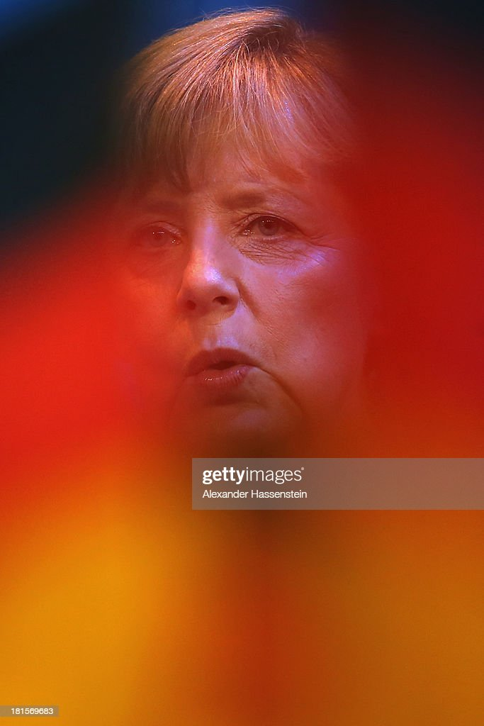 Angela Merkel, German Chancellor and Chairwoman of the German Christian Democrats (CDU), celebrates with supporters at CDU headquarters Konrad-Adenauer-Haus after initial results give the CDU 42% of the vote in German federal elections on September 22, 2013 in Berlin, Germany. Germany is holding federal elections that will determine whether Merkel will remain chancellor for a third term. Though the CDU has a strong lead over the opposition, its partner party in the current government coalition, the German Free Democrats (FDP), failed to gain the 5% necessary to retain seats in the Bundestag and speculations run wide as to what coalition will be viable in coming weeks to create a new government.