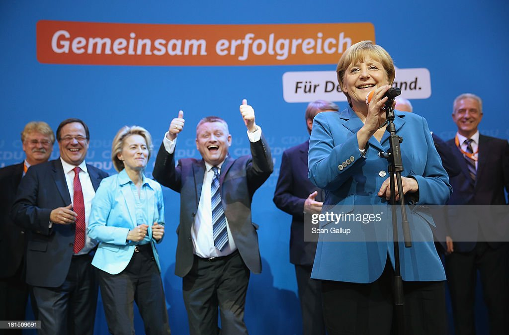 <a gi-track='captionPersonalityLinkClicked' href=/galleries/search?phrase=Angela+Merkel&family=editorial&specificpeople=202161 ng-click='$event.stopPropagation()'>Angela Merkel</a>, German Chancellor and Chairwoman of the German Christian Democrats (CDU), celebrates with other members f her party, including CDU General Secretary <a gi-track='captionPersonalityLinkClicked' href=/galleries/search?phrase=Hermann+Groehe&family=editorial&specificpeople=6400355 ng-click='$event.stopPropagation()'>Hermann Groehe</a> (gesturing) and Minister of Work and Social Issues <a gi-track='captionPersonalityLinkClicked' href=/galleries/search?phrase=Ursula+von+der+Leyen&family=editorial&specificpeople=4249207 ng-click='$event.stopPropagation()'>Ursula von der Leyen</a> (3rd from L) at CDU headquarters after initial results give the CDU 42% of the vote in German federal elections on September 22, 2013 in Berlin, Germany. Germany is holding federal elections that will determine whether Merkel will remain chancellor for a third term. Though the CDU has a strong lead over the opposition, its partner party in the current government coalition, the German Free Democrats (FDP), failed to gain the 5% necessary to retain seats in the Bundestag and speculations run wide as to what coalition will be viable in coming weeks to create a new government.