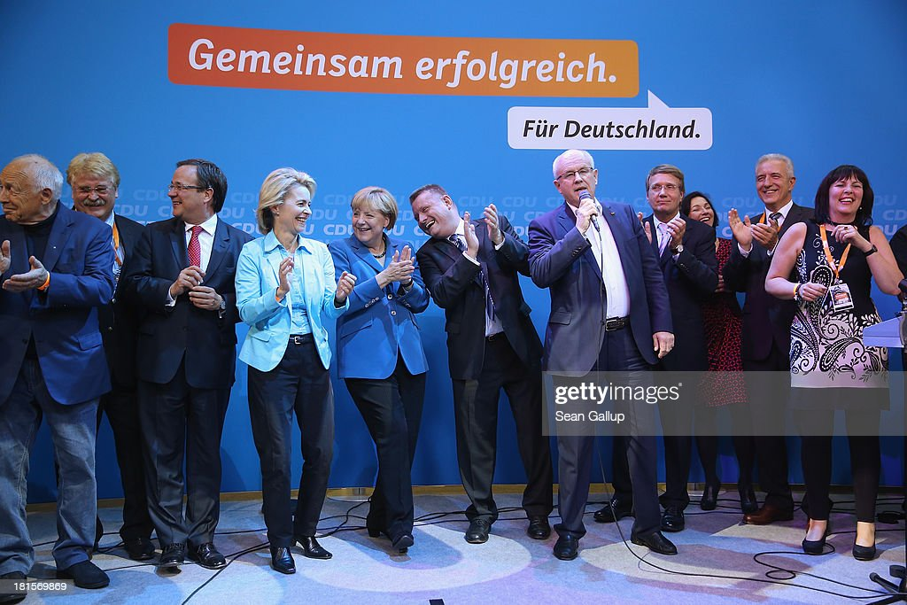 Angela Merkel (5th from L), German Chancellor and Chairwoman of the German Christian Democrats (CDU), celebrates with other members f her party, including CDU General Secretary Hermann Groehe (R of her) and Minister of Work and Social Issues Ursula von der Leyen (4th from L) at CDU headquarters after initial results give the CDU 42% of the vote in German federal elections on September 22, 2013 in Berlin, Germany. Germany is holding federal elections that will determine whether Merkel will remain chancellor for a third term. Though the CDU has a strong lead over the opposition, its partner party in the current government coalition, the German Free Democrats (FDP), failed to gain the 5% necessary to retain seats in the Bundestag and speculations run wide as to what coalition will be viable in coming weeks to create a new government.
