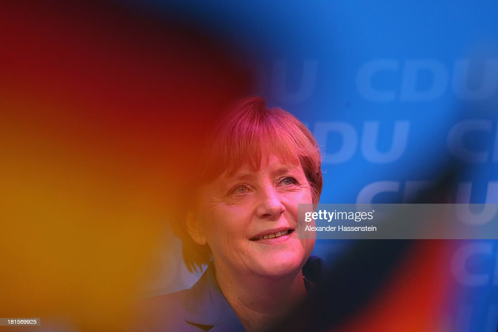 <a gi-track='captionPersonalityLinkClicked' href=/galleries/search?phrase=Angela+Merkel&family=editorial&specificpeople=202161 ng-click='$event.stopPropagation()'>Angela Merkel</a>, German Chancellor and Chairwoman of the German Christian Democrats (CDU), celebrates with supporters at CDU headquarters Konrad-Adenauer-Haus after initial results give the CDU 42% of the vote in German federal elections on September 22, 2013 in Berlin, Germany. Germany is holding federal elections that will determine whether Merkel will remain chancellor for a third term. Though the CDU has a strong lead over the opposition, its partner party in the current government coalition, the German Free Democrats (FDP), failed to gain the 5% necessary to retain seats in the Bundestag and speculations run wide as to what coalition will be viable in coming weeks to create a new government.