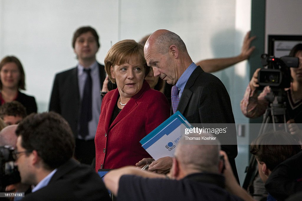 <a gi-track='captionPersonalityLinkClicked' href=/galleries/search?phrase=Angela+Merkel&family=editorial&specificpeople=202161 ng-click='$event.stopPropagation()'>Angela Merkel</a>, German Federal Chancellor and member of the Christian Democratic Union, CDU, and <a gi-track='captionPersonalityLinkClicked' href=/galleries/search?phrase=Pascal+Lamy&family=editorial&specificpeople=220438 ng-click='$event.stopPropagation()'>Pascal Lamy</a> , Director General of the World Trade Organization, WTO , on the way to a press conference.