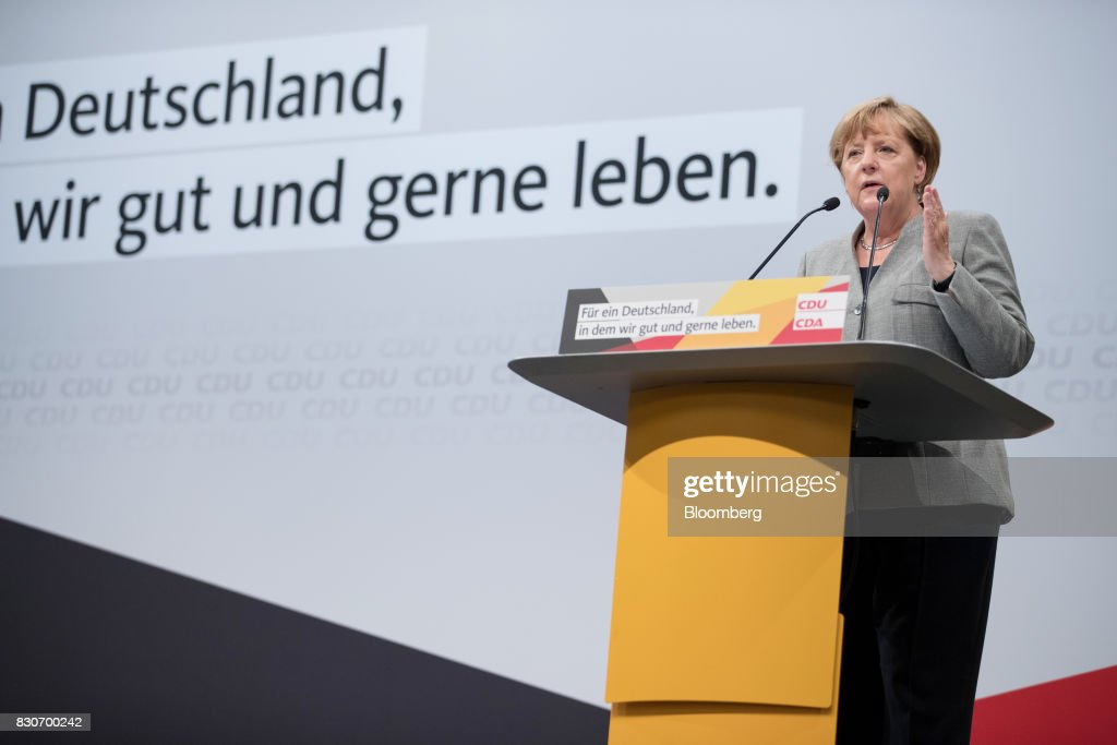 Angela Merkel, Germany's chancellor and Christian Democratic Union (CDU) leader, speaks during a campaign event in Dortmund, Germany, on Saturday, Aug. 12, 2017. Merkelopened her re-election campaign with criticism of the nations auto executives, saying they need to embrace new technology more quickly to protect jobs and repair damage done by adiesel cheating scandal. Photographer: Jasper Juinen/Bloomberg via Getty Images