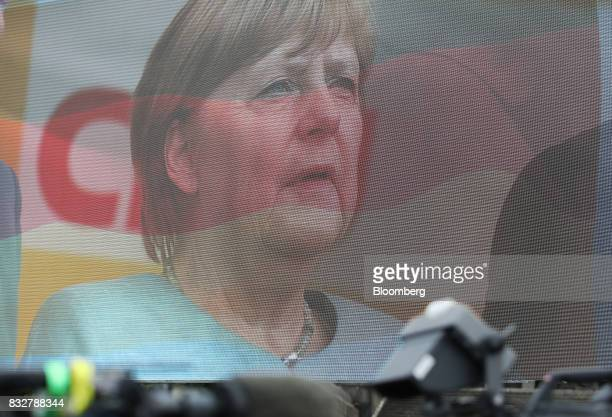 Angela Merkel Germany's chancellor and Christian Democratic Union leader is seen on a large monitor during an election campaign stop in Koblenz...