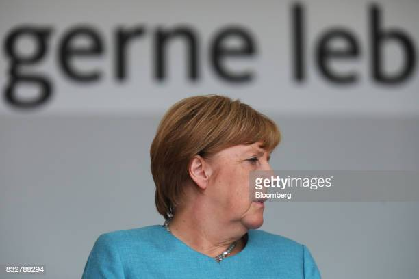 Angela Merkel Germany's chancellor and Christian Democratic Union leader listens during an election campaign stop in Koblenz Germany on Wednesday Aug...