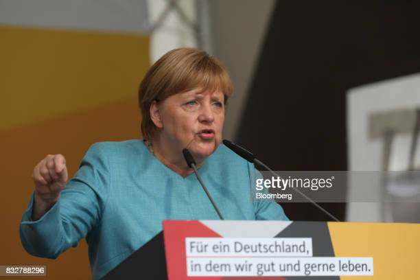 Angela Merkel Germany's chancellor and Christian Democratic Union leader speaks during an election campaign stop in Koblenz Germany on Wednesday Aug...