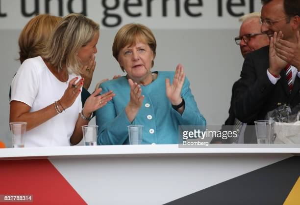 Angela Merkel Germany's chancellor and Christian Democratic Union leader center applauds during an election campaign stop in Koblenz Germany on...
