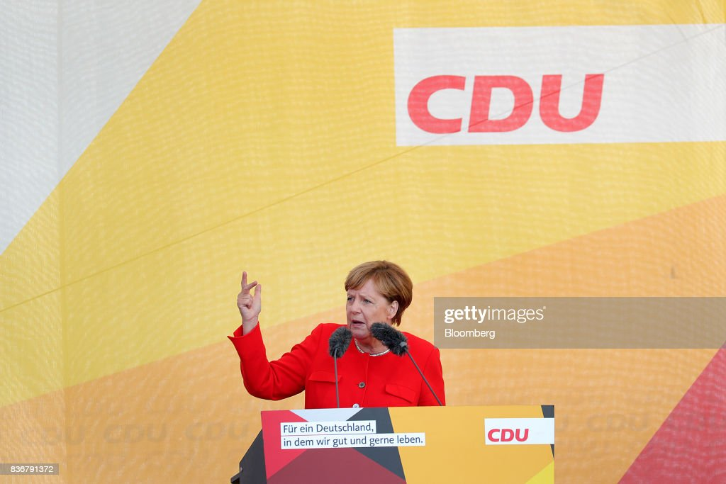 Angela Merkel, Germany's chancellor and Christian Democratic Union (CDU) leader, gestures while speaking during an election campaign stop in Saint Peter-Ording, Germany, on Monday, Aug. 21, 2017. Merkel headed out on the campaign trail last week and quickly faced disruption by anti-immigration demonstrators, a reminder that the refugee crisis that sent her popularity plunging in 2016 remains a residual risk. Photographer: Krisztian Bocsi/Bloomberg via Getty Images