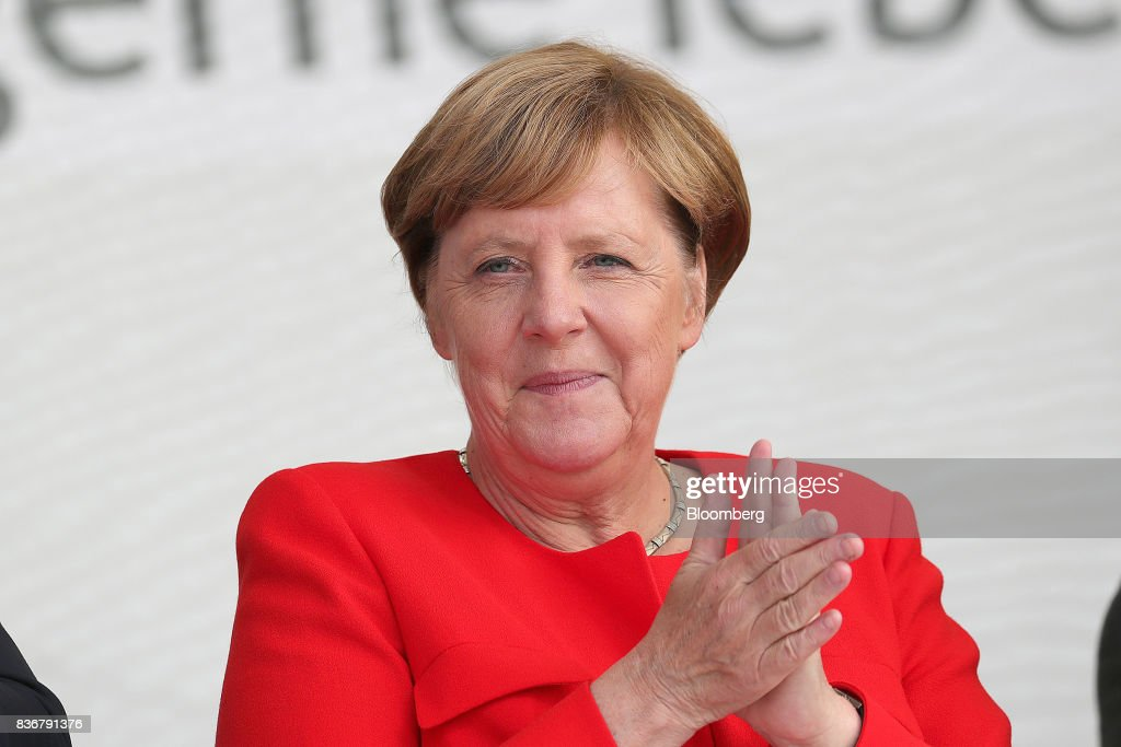 Angela Merkel, Germany's chancellor and Christian Democratic Union (CDU) leader, applauds during an election campaign stop in Saint Peter-Ording, Germany, on Monday, Aug. 21, 2017. Merkel headed out on the campaign trail last week and quickly faced disruption by anti-immigration demonstrators, a reminder that the refugee crisis that sent her popularity plunging in 2016 remains a residual risk. Photographer: Krisztian Bocsi/Bloomberg via Getty Images
