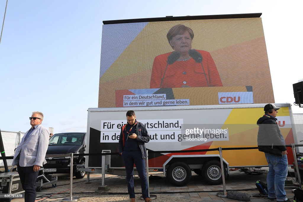 Angela Merkel, Germany's chancellor and Christian Democratic Union (CDU) leader, speaks during an election campaign stop in Saint Peter-Ording, Germany, on Monday, Aug. 21, 2017. Merkel headed out on the campaign trail last week and quickly faced disruption by anti-immigration demonstrators, a reminder that the refugee crisis that sent her popularity plunging in 2016 remains a residual risk. Photographer: Krisztian Bocsi/Bloomberg via Getty Images