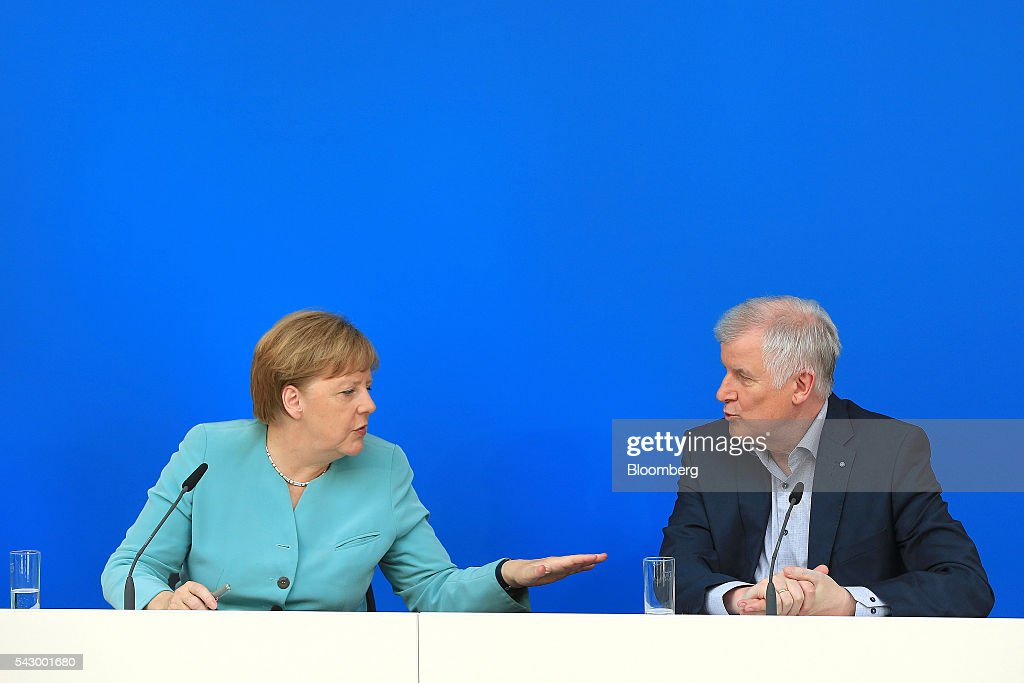 Angela Merkel, Germany's chancellor and leader of the Christian Democratic Union (CDU) party, left, speaks with Horst Seehofer, Bavarian premier and leader of the Christian Social Union (CSU) party, during a news conference in Potsdam, Germany, on Saturday, June 25, 2016. Merkel signaled she wants to avoid punishing the U.K. as it leaves the European Union, though the exit talks shouldnt drag on forever. Photographer: Krisztian Bocsi/Bloomberg via Getty Images