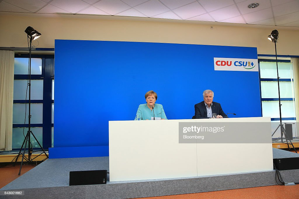 Angela Merkel, Germany's chancellor and leader of the Christian Democratic Union (CDU) party, left, and Horst Seehofer, Bavarian premier and leader of the Christian Social Union (CSU) party, speak during a news conference in Potsdam, Germany, on Saturday, June 25, 2016. Merkel signaled she wants to avoid punishing the U.K. as it leaves the European Union, though the exit talks shouldnt drag on forever. Photographer: Krisztian Bocsi/Bloomberg via Getty Images
