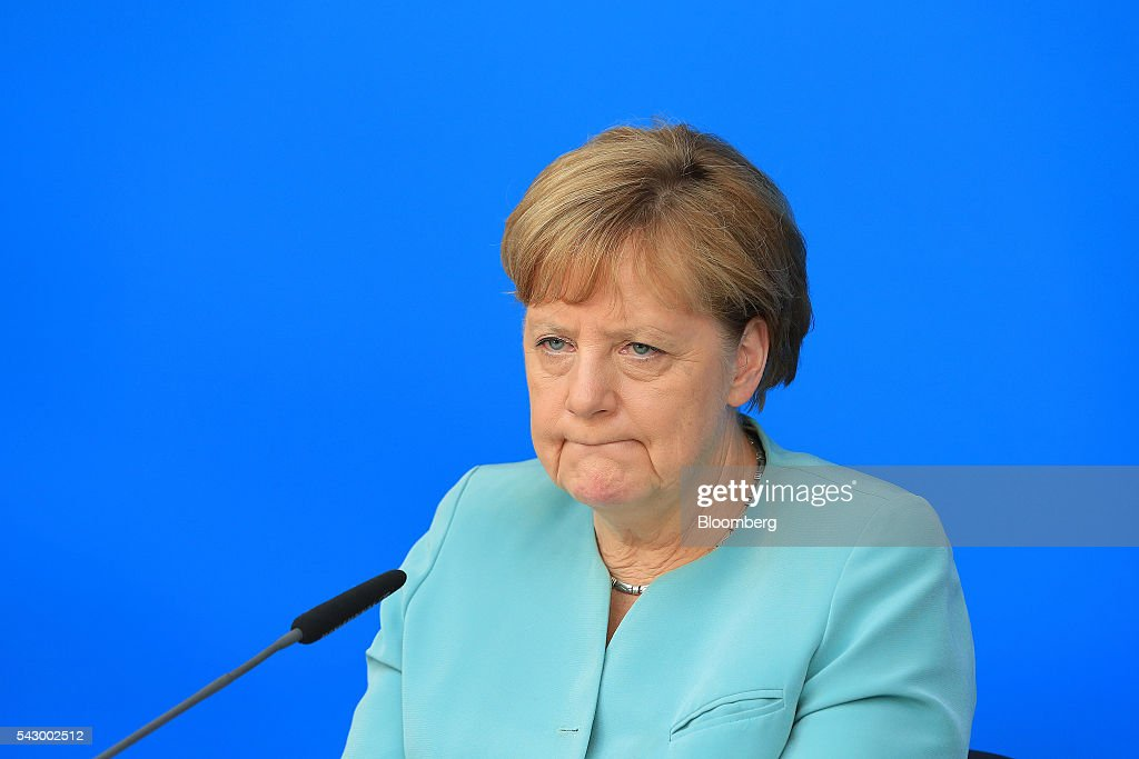 Angela Merkel, Germany's chancellor and leader of the Christian Democratic Union (CDU) party, reacts during a news conference in Potsdam, Germany, on Saturday, June 25, 2016. Merkel signaled she wants to avoid punishing the U.K. as it leaves the European Union, though the exit talks shouldnt drag on forever. Photographer: Krisztian Bocsi/Bloomberg via Getty Images