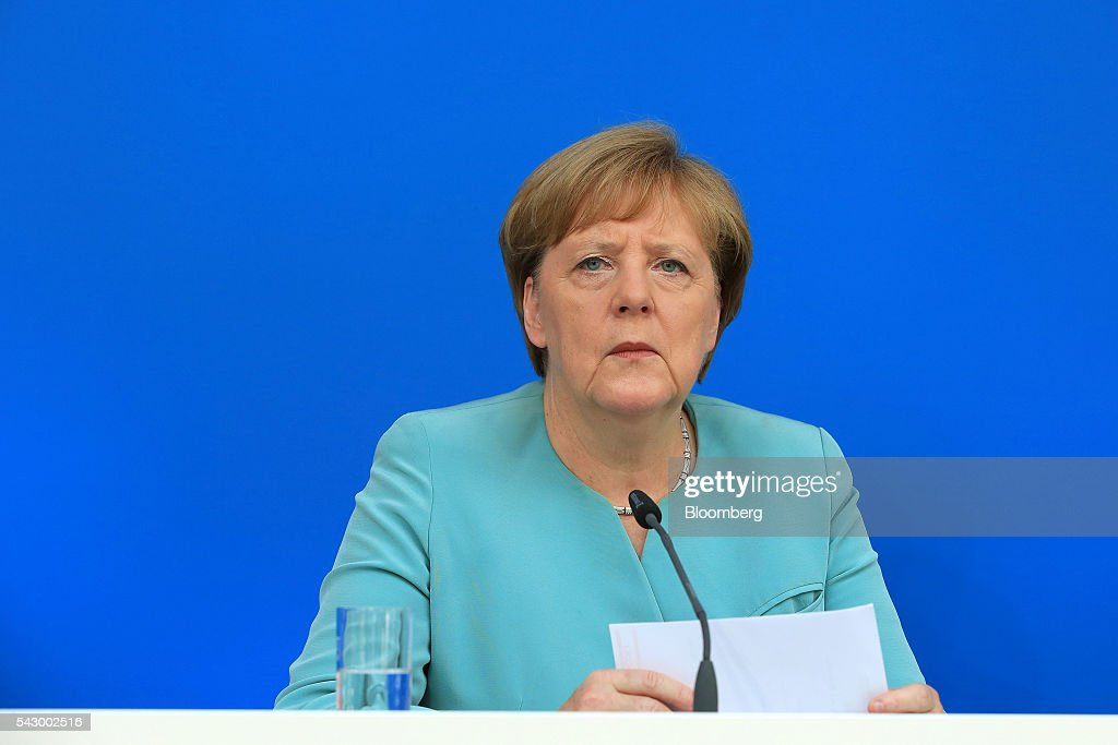Angela Merkel, Germany's chancellor and leader of the Christian Democratic Union (CDU) party, listens during a news conference in Potsdam, Germany, on Saturday, June 25, 2016. Merkel signaled she wants to avoid punishing the U.K. as it leaves the European Union, though the exit talks shouldnt drag on forever. Photographer: Krisztian Bocsi/Bloomberg via Getty Images