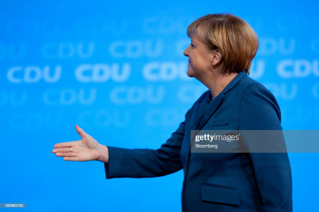 <a gi-track='captionPersonalityLinkClicked' href=/galleries/search?phrase=Angela+Merkel&family=editorial&specificpeople=202161 ng-click='$event.stopPropagation()'>Angela Merkel</a>, Germany's chancellor and party leader of the Christian Democratic Union (CDU), reaches out her hand in greeting during an election rally in Potsdam, Germany, on Monday, Sept. 16, 2013. Delayed plans for a financial transaction tax in 11 European states would get a fresh push if Chancellor <a gi-track='captionPersonalityLinkClicked' href=/galleries/search?phrase=Angela+Merkel&family=editorial&specificpeople=202161 ng-click='$event.stopPropagation()'>Angela Merkel</a> enters a coalition with the Social Democrats after Sept. 22 German elections, top SPD members said. Photographer: Krisztian Bocsi/Bloomberg via Getty Images