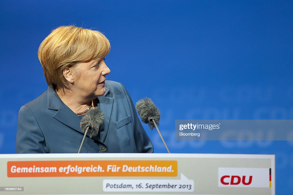 <a gi-track='captionPersonalityLinkClicked' href=/galleries/search?phrase=Angela+Merkel&family=editorial&specificpeople=202161 ng-click='$event.stopPropagation()'>Angela Merkel</a>, Germany's chancellor and party leader of the Christian Democratic Union (CDU), speaks during an election rally in Potsdam, Germany, on Monday, Sept. 16, 2013. Delayed plans for a financial transaction tax in 11 European states would get a fresh push if Chancellor <a gi-track='captionPersonalityLinkClicked' href=/galleries/search?phrase=Angela+Merkel&family=editorial&specificpeople=202161 ng-click='$event.stopPropagation()'>Angela Merkel</a> enters a coalition with the Social Democrats after Sept. 22 German elections, top SPD members said. Photographer: Krisztian Bocsi/Bloomberg via Getty Images