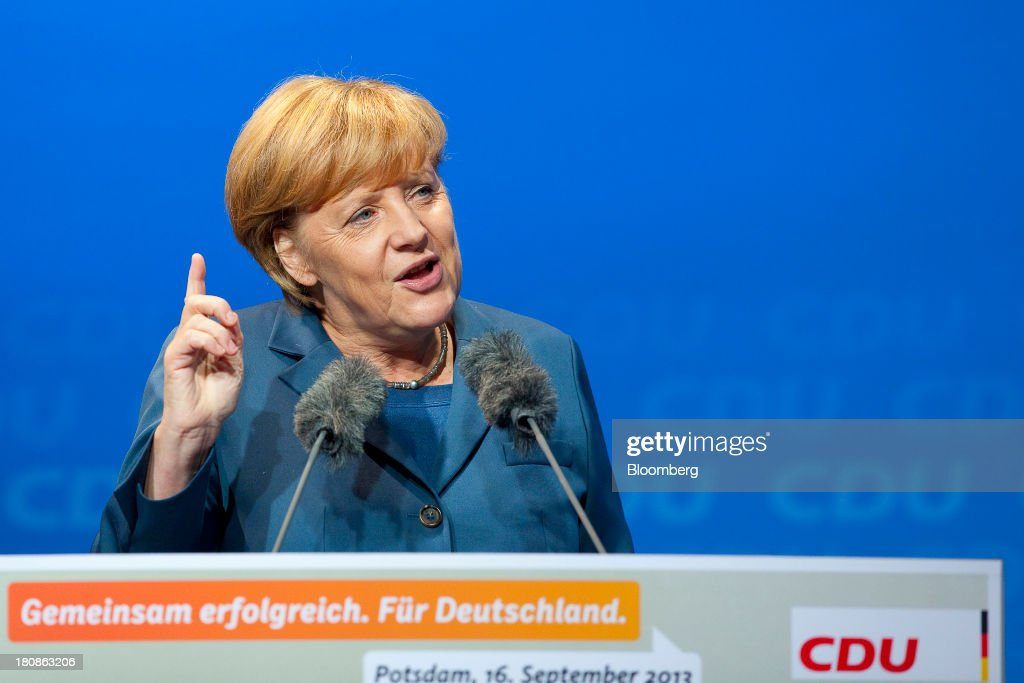 <a gi-track='captionPersonalityLinkClicked' href=/galleries/search?phrase=Angela+Merkel&family=editorial&specificpeople=202161 ng-click='$event.stopPropagation()'>Angela Merkel</a>, Germany's chancellor and party leader of the Christian Democratic Union (CDU), gestures during an election rally in Potsdam, Germany, on Monday, Sept. 16, 2013. Delayed plans for a financial transaction tax in 11 European states would get a fresh push if Chancellor <a gi-track='captionPersonalityLinkClicked' href=/galleries/search?phrase=Angela+Merkel&family=editorial&specificpeople=202161 ng-click='$event.stopPropagation()'>Angela Merkel</a> enters a coalition with the Social Democrats after Sept. 22 German elections, top SPD members said. Photographer: Krisztian Bocsi/Bloomberg via Getty Images