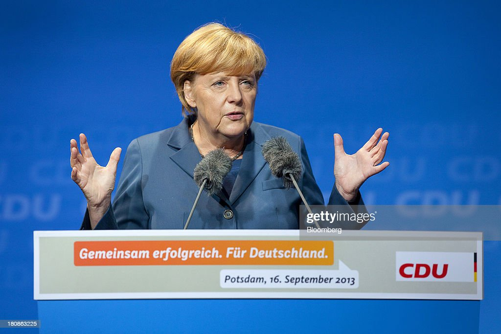 <a gi-track='captionPersonalityLinkClicked' href=/galleries/search?phrase=Angela+Merkel&family=editorial&specificpeople=202161 ng-click='$event.stopPropagation()'>Angela Merkel</a>, Germany's chancellor and party leader of the Christian Democratic Union (CDU), gestures as she speaks during an election rally in Potsdam, Germany, on Monday, Sept. 16, 2013. Delayed plans for a financial transaction tax in 11 European states would get a fresh push if Chancellor <a gi-track='captionPersonalityLinkClicked' href=/galleries/search?phrase=Angela+Merkel&family=editorial&specificpeople=202161 ng-click='$event.stopPropagation()'>Angela Merkel</a> enters a coalition with the Social Democrats after Sept. 22 German elections, top SPD members said. Photographer: Krisztian Bocsi/Bloomberg via Getty Images