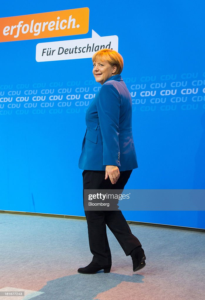 Angela Merkel, Germany's chancellor and party leader of the Christian Democratic Union (CDU), smiles before her speech at the CDU headquarters after the German federal elections initial results were announced in Berlin, Germany, on Sunday, Sept. 22, 2013. Merkel won an overwhelming endorsement from German voters, putting the country's first female chancellor on course for the biggest election tally since Helmut Kohl's post-reunification victory of 1990. Photographer: Krisztian Bocsi/Bloomberg via Getty Images